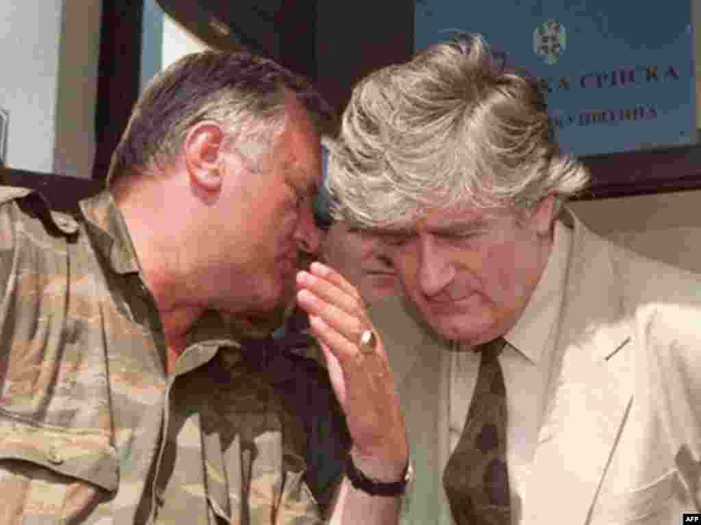 Bosnian Serb commander Ratko Mladic (left) whispers to Radovan Karadzic during a press conference in 1993 - Bosnian Serb wartime leader Radovan Karadzic has been arrested near Belgrade after evading capture for 11 years. Along with Bosnian Serb commander Ratko Mladic, who is still at large, Karadzic is considered the architect of the worst atrocities in Europe since World War II.