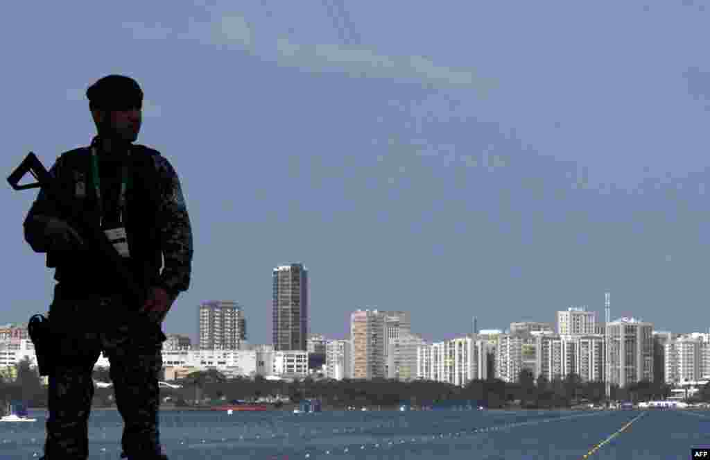 A member of Brazil's national security forces looks on during the rowing competition.