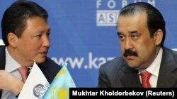 Кәрім Мәсімов (оң жақта) Тимур Құлыбаевпен бірге Kazenergy жиынында отыр. Астанa, 4 қазан 2011.