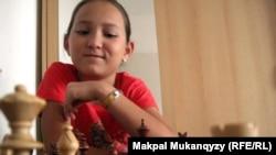 Жансая Абдумалик, международный мастер по шахматам.