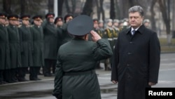 Ukrainian President Petro Poroshenko (right) visits the National Defense University in Kyiv on February 27.