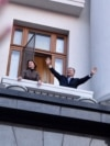"UKRAINE -- Outgoing Ukrainian President Petro Poroshenko and his wife Maryna greet people from the balcony of his office during a rally of his supporters called ""Thank you"" in Kyiv, April 22, 2019"