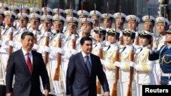 Hytaý Halk Respublikasynyň başlygy Şi Jinpin we Türkmenistanyň prezidenti Gurbanguly Berdimuhamedow. Pekin, 12-nji maý, 2014.