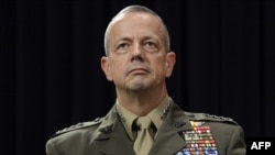 U.S. General John Allen looks on following a meeting of NATO defense ministers at NATO headquarters in Brussels in early October.