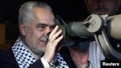 Iranian Vice President Mohammad Reza Rahimi uses a pair of binoculars as he looks toward the Israeli border from the Iranian garden of Maroun al-Ras in May.