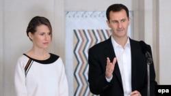Дружина президента Сирії Асма Асад (л) разом із чоловіком, ілюстративне фото