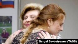 Butina hugs Kremlin-appointed human rights commissioner Tatyana Moskalkova on November 18.