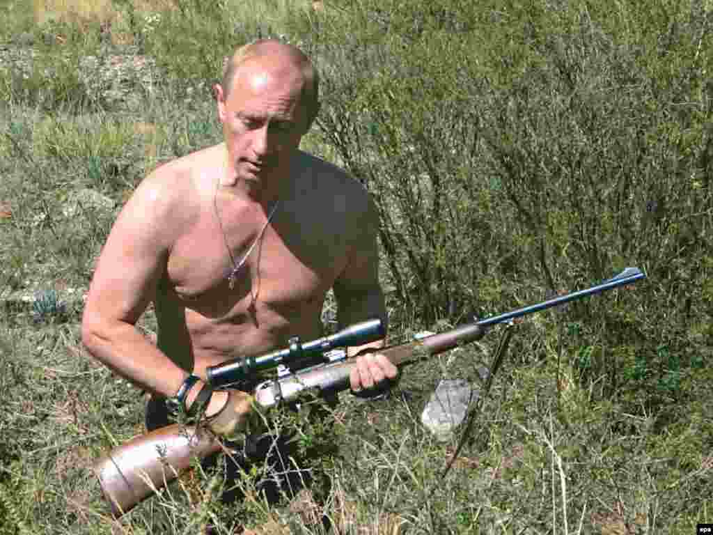A shirtless Putin famously hunts in the foothills of the Sayan Mountains in the Republic of Tuva in August 2007.