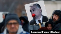 A placard depicting Hungarian Prime Minister Viktor Orban is pictured during a protest against the labor law in Budapest on December 16.