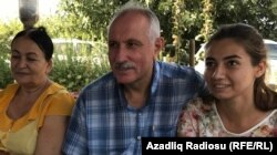 A happy Mehman Aliyev, with his wife Zemfira Aliyeva (left) and their daughter, Leyla, after his release from prison on September 11.