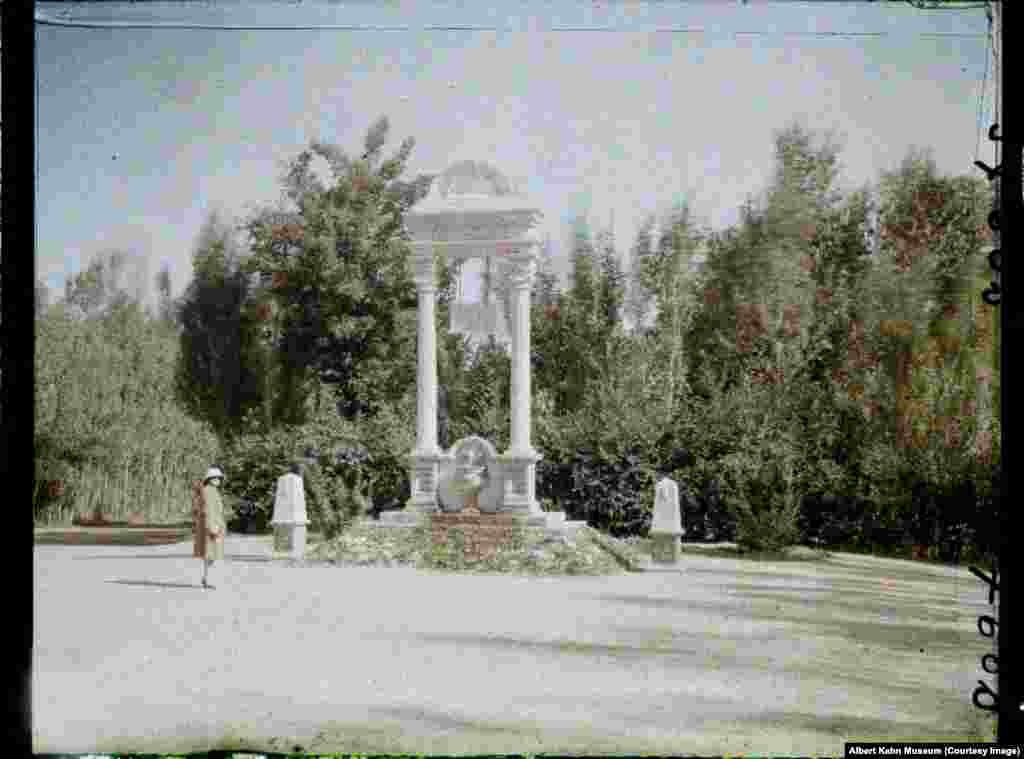 A European woman strolling through the Paghman gardens. Today the area is used for dog-fighting contests.
