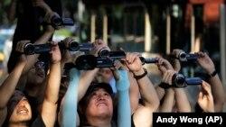 Novinari, Kina, fotoarhiv