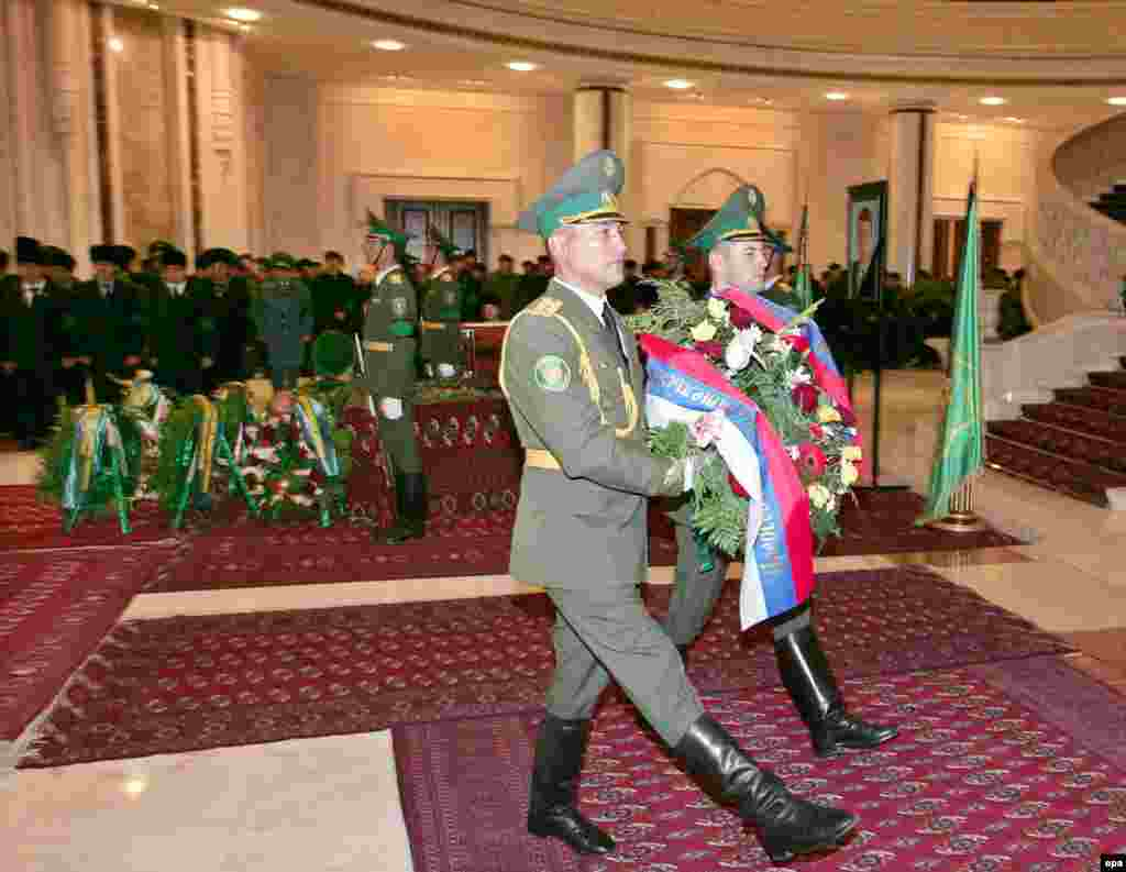 "An honor guard presents a wreath from the Russian government at the service for Niyazov in Ashgabat (epa) - ""There were 20 delegations at the level of heads of state and government, mostly from regional countries: Iran, Uzbekistan, Kazakhstan, Afghanistan,"" Drabok said. ""Russia was represented by Prime Minister Mikhail Fradkov. Western countries were represented by ambassadors. No officials spoke at the farewell ceremony."""