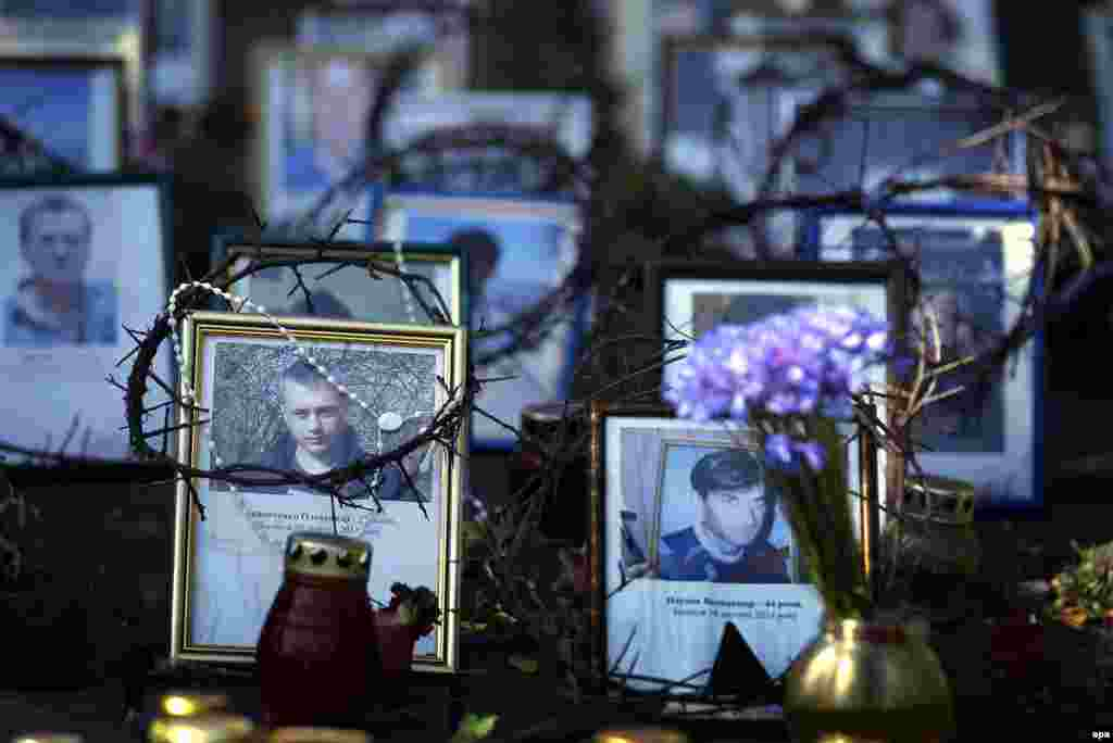 Portraits of those who died during the violent protests at the Maidan Square, displayed at an improvised memorial close to a polling station in central Kyiv.