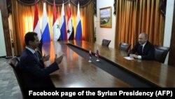 Президент Путин Хмеймимде Сирия президенти Башар Асад менен жолукту.