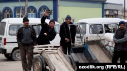 Uzbekistan - boys who are working in the bazaar waiting for their clients, 25Mar2012