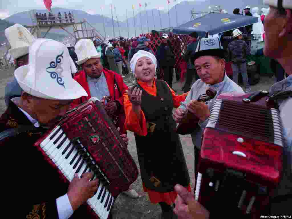 "Nazira Ivanova rehearses with her bandmates before taking the stage at an event for traditional music. The song, which stopped several passersby in their tracks, was ""about love,"" she told RFE/RL."
