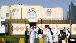 FILE: Guests arrive for the opening ceremony of the new Taliban political office in Doha on 18Jun2013.