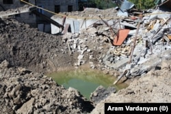 A large explosion left a massive crater at this site in Stepanakert.