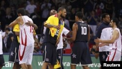U.S. and Iranian national basketball players congratulate each other following their game at FIBA's world championships in Istanbul on September 1.