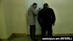 RFE/RL journalist Karlen Aslanian speaks with David Petrosian, who together with four other protesters went on a hunger strike inside a locked lecture room of Yerevan State University on November 14.