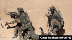 FILE: Afghan special forces take part in a military exercise in November 2017.