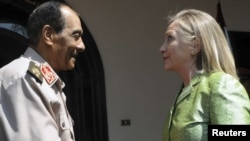 Egypt's military chief, Field Marshal Hussein Tantawi (left), meets with U.S. Secretary of State Hillary Clinton in Cairo on July 15.