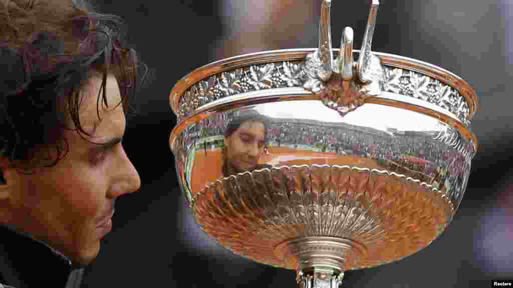 Nadal got his revenge a few months later when he beat Djokovic to claim a record-breaking seventh French Open title at the Roland Garros stadium in Paris on June 11. (Reuters/Benoit Tessier)