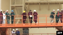 Russian and Iranian workers and technicians at the Bushehr nuclear power plant in February 2009