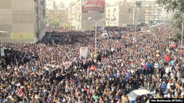 "Egyptian protesters, gather in Cairo. Some of the demonstrators demanded President Muhammad Morsi's overthrow, chanting ""Leave, leave."""