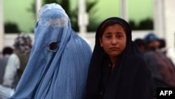 An Afghan woman pictured here with her daughter (file photo)