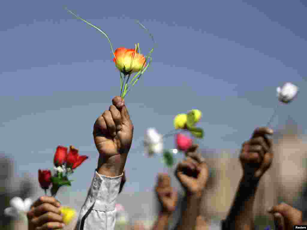Opposition supporters wave roses during an antigovernment protest in Sanaa, Yemen, on January 26, as the Arab Spring protests spread. After waging a months-long crackdown on protesters, President Ali Abdullah Saleh eventually stepped down. (Reuters/Khaled