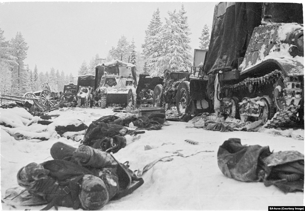 Dead Soviet soldiers lie in the aftermath of a devastating attack on a Soviet column on the Raate Road in January 1940.