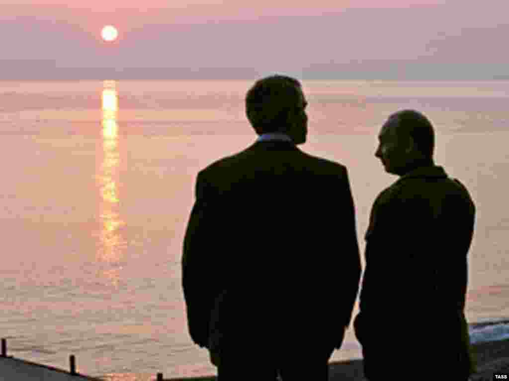 U.S.-Russia relations - U.S. President George W. Bush (left) and his Russian counterpart Vladimir Putin watch the sunset at the Bocharov Ruchei residence at the Black Sea.