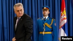 Serbian President Tomislav Nikolic leaves a press conference in Belgrade on January 29 after calling early parliamentary elections.