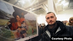Poturovic stands by his prize-winning shot at the New Temple gallery in Sarajevo.