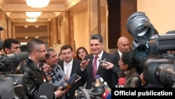 Armenian Prime Minister Tigran Sarkisian talks to the press on October 26.