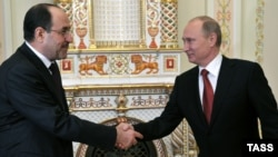 Russian President Vladimir Putin meets with Iraqi Prime Minister Nuri al-Maliki on October 10.