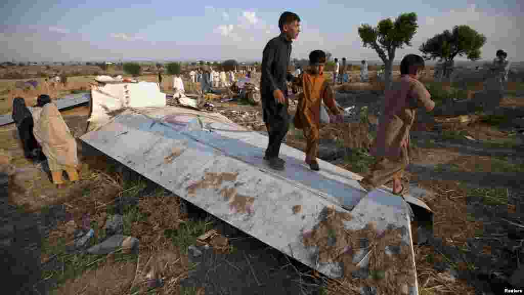 Children play on the wreckage of a Boeing 737 airliner, which crashed in Islamabad on April 20. (Reuters/Faisal Mahmood)