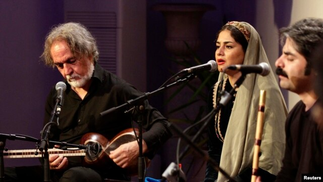 Iranian musician Majid Derakhshani (left) performs at a festival in Tunisia earlier this year.