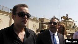 "Журналисты ""Аль-Джазиры"" канадец Мохамед Фахми и египтянин Бахер Мохамед"