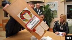 Electoral commission staff empties a ballot box in the capital, Minsk, after polling stations closed in Belarus's parliamentary elections on September 23.