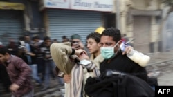 A protester is carried away during clashes with security forces Tahrir Square in Cairo on November 21.