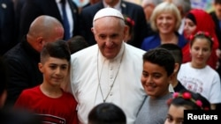 Pope Francis meets refugees at a refugee center near Sofia, Bulgaria, last month.