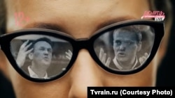 Russian opposition campaigner Aleksei Navalny is reflected in the sunglasses of socialite and presidential hopeful Ksenia Sobchak. (photo illustration)