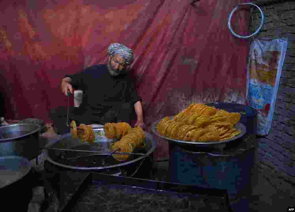 An Afghan worker prepares sweets at a traditional factory ahead of the holy month of Ramadan at the Chendawol market in Kabul. (AFP/Wakil Kohsar)
