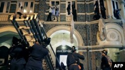 Firefighters rescue employees and guests of the Taj Mahal Hotel in downtown Mumbai, one of the scenes of the shootouts with gunmen in the November 2008 attacks.