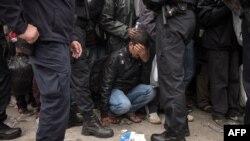 Migrant među službenicima hrvatske policije, rujan 2015.