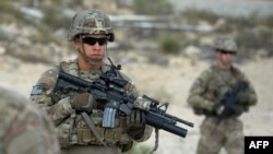 FILE: U.S. soldiers patrol during a month-long anti-Taliban operation by the Afghan National Army.