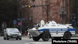 A police armored vehicle patrols a street in the Armenian capital of Yerevan on March 25.